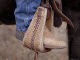 A Close-up of a Cowboy Boot in a Stirrup in the Nebraska Sandhills