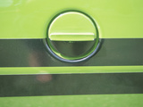 Vintage Gas Tank on a Green Classic Car