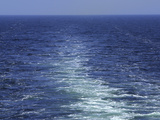 An Expanse of a Wake Behind a Boat on the Blue Sea