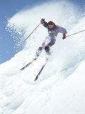 Alpine Skiing  Downhill Skier Blasting a Cornice