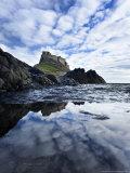 Castle Reflected in Pool with Mackerel Sky  Northumberland  UK
