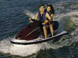 Mid Adult Couple Riding a Jet Ski