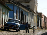 A Cuban Man Gets out of His Car with His Child