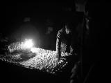 An Afghan Vendor Sells Eggs by Lantern Light