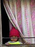 A Nepali Child Looks out from a Window at Pro-Democracy Activists
