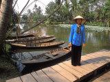 Woman Near Old Boats  Mekong Delta  Vietnam