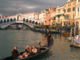 Gondola with Tourists in the Grand Canal  Venice  Italy
