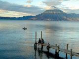Sunrise over Lake Atitlan and Women on End of the Pier  Solola  Guatemala