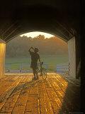 Bicyclist at Covered Bridge  Iowa  USA
