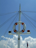 Sailboat Mast and Life Preserver Against Sky
