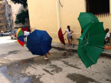 Girls with Umbrellas in Street of Old Havana  Havana  Cuba
