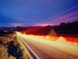 Vehicle Lights and Lightning Illuminating Road  Arches National Park  Utah  USA