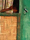 Young Child Peeking Out from Behind Curtain at Watukarare  Sumba  East Nusa Tenggara  Indonesia