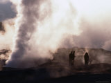 People Silhouetted Against Steam from Geyser Vent  Sol De Manana  Bolivia
