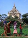 Villagers Walking on Path Near Thatbyinnyu Old Bagan  Mandalay  Myanmar (Burma)