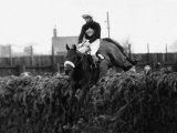 Grand National 1973 Red Rum Ridden by Brian Fletcher Jumps a Fence and Goes on to Win