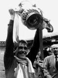 Liverpool Player Manager Kenny Dalglish Holding the Trophy After Their Win Against Everton