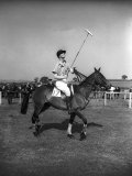 Prince Philips Rides Along on Horseback Holding Polo Stick During Game