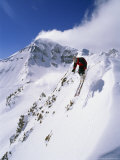 Downhill Skier Launching Off a Cornice in Front of Lone Mountain