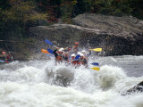 Rafters Riding the Rock Strewn Gauley River Through a Mountain Gorge