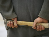 Stone-Cutter's Hands Hold a Rock Chisel Used For Carving Marble