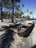 An Outrigger Canoe Rests on a Beach