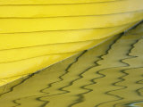 Yellow Boat Casting Its Reflection on the Water's Surface