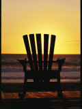 Lawn Chair on a Beach at Sunset