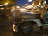 Jeepney Speeds Through Night in Malate