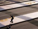Teenage Boy Skateboarding on Road  Docklands