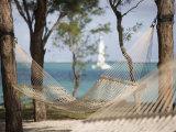 Beach Hammock with Catamaran in Background  Private Island of Le Tuessrok Resort