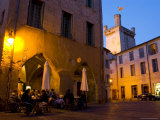 Outdoor Dining in Uzes  with Duche D'Uzes Illuminated at Dusk