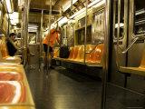 Man Looking at Map on Subway Train