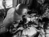 Cpl James Farley and Pfc Wayne Hoilien Bandaging Sgt Billie Owens' Shoulder  Yankee Papa 13
