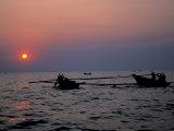 Silhouetted Boats on Lake Tanganyika  Tanzania