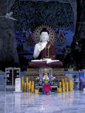 Monk Praying Near Buddha Statue  Thailand