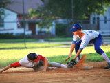 Baseball Player Sliding into Base