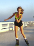 Young Woman on Rollerblades at the Beach