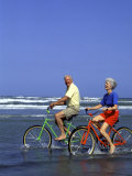 Retired Couple Riding Bikes at the Beach
