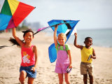 Children Flying Kites on the Beach
