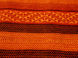 Detail of Handmade Orange and Black Wool Textile Blanket  Pisac Market  Peru