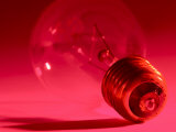 Studio Shot of Light Bulb in Red Light