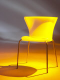 Studio Shot of Modern Plastic Yellow Chair