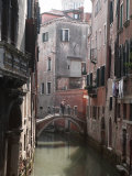 Young Adult Couple Hugging and Kissing on Bridge over Canal  Venice  Italy