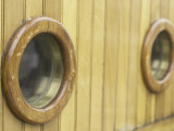 Detail of Porthole Windows on Wooden Surface of Sailboat