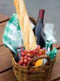 Picnic Basket with Glassware and Picnic Foods Including Bread and Grapes with Wine