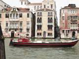 Speedboat on Canal by Row of Houses in Venice  Italy