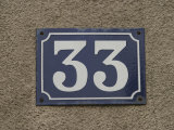 Number 33 Address Plaque on a Textured Wall