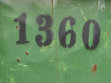 Painted Numbers on Weathered Green Painted Wall