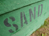 Sand Painted on Bright Green Wood Plank Wall